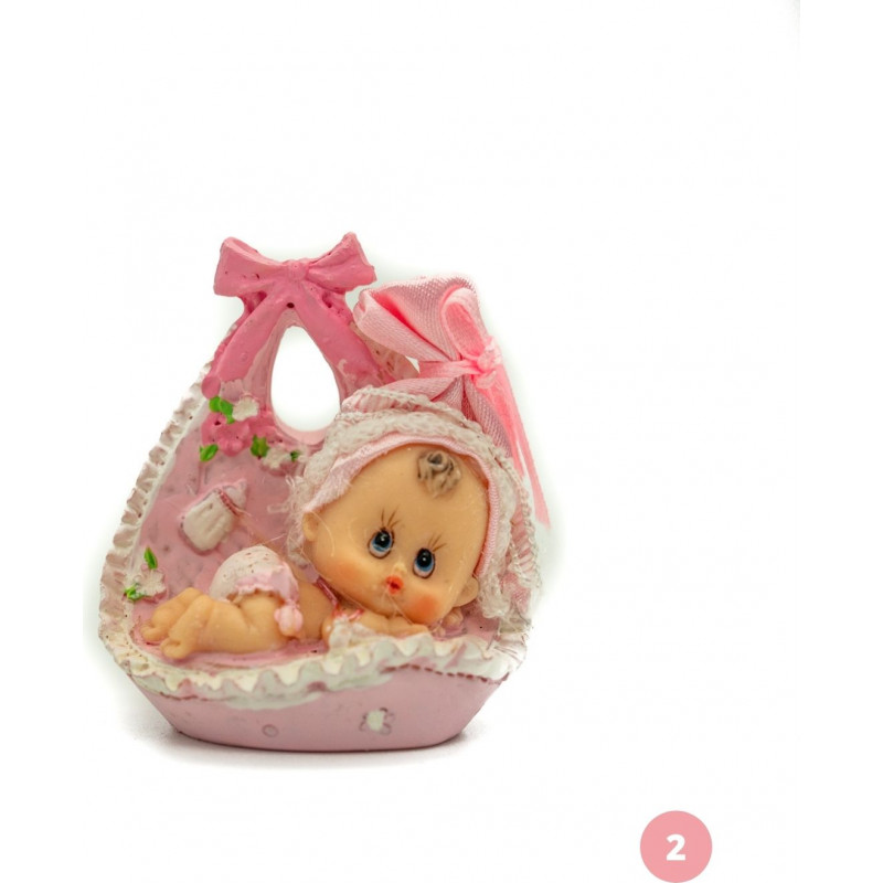 Baby in a pink basket